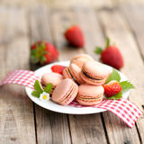 Macaroons with strawberries Stock Photos