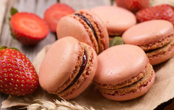 Macaroons with strawberries Stock Images