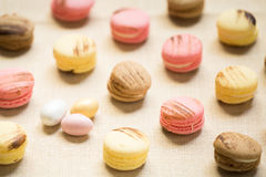 Macaroons with sweet eggs on a linen napkin Royalty Free Stock Image