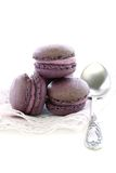 Macaroons and teaspoon. Stock Photography