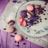 Macaroons on vintage background. Different kinds of macaroons. Food photo. Vintage background stock images