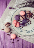 Macaroons on vintage background. Different kinds of macaroons. Food photo. Vintage background royalty free stock photo