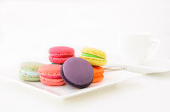 Macaroons on white plate and coffee cup Stock Images