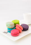 Macaroons on white plate and coffee cup Royalty Free Stock Image