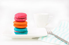 Macaroons on white plate and coffee cup Stock Photography