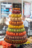 Macaroons in the window of a confectionery Royalty Free Stock Photos