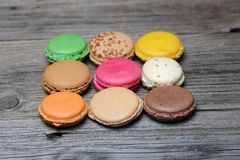 Macaroons. On the wooden table stock photos