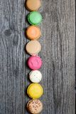 Macaroons. On the wooden table royalty free stock photography