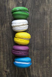 Macaroons on wooden table Stock Photography