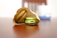 Macaroons on wooden table Stock Photo