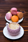 Macaroons on the wooden table Stock Images