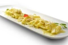 Macarrão de Paccheri do prato da massa com cebola e calamar 2 Imagens de Stock Royalty Free