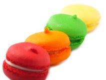 Macarrones coloridos en blanco Imagen de archivo