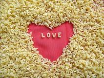 Macarronetes e amor Imagens de Stock Royalty Free