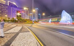 MACAU, CHINA - APRIL 2014: City streets and casinos at night. Ma. Cau attracts 20 million people annually Stock Photo