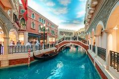 MACAU, CHINA - JANUARY 24, 2016: The Venetian Macau Resort Hotel interior view. MACAU, CHINA - JANUARY 24, 2016: The mock Venetian canal in the Venetian Macau stock photo