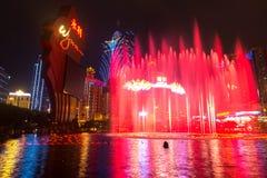Macau, China - 2014.10.15: Macau - the gambling capital of Asia. The photo of the dancing fountain show at the famous Wynn hotel. Macau - the gambling capital stock photography