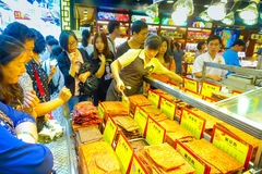 MACAU, CHINA- MAY 11, 2017: An unidentified people watching a delicious chinese food, dried meat slice Royalty Free Stock Image