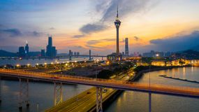 Macau city skyline at sunset with Macau Tower in twilight, Aerial view, Macau, China.  royalty free stock photography