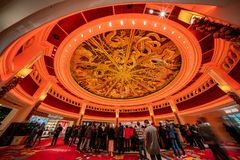 People waiting for the famous show - Tree of prosperity, Dragon of fortune of Wynn Macau. Macau, DEC 24: People waiting for the famous show - Tree of prosperity royalty free stock photography