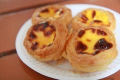 Macau Egg Tarts. Signature egg tarts in Macau, original breakfast set for native people, must-eat for tourist Royalty Free Stock Image