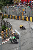 Macau GP with Peter Hickman, Michael Rutter at Reservoir bend and crowd in background. Stock Photos