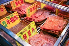 Macau - January 15, 2018 :Traditional dry meat in shop in historic quarter in Macau royalty free stock photos