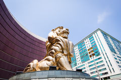 Macau, a statue of a golden lion Royalty Free Stock Photo