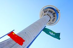 Macau Tower and Flag, Macau, China. Macau Tower Convention & Entertainment Centre is a tower located in Sé, Macau, China. The tower measures 338 m 1,109 ft in Stock Photos