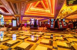 Macau Venetian Casino. Macau, China - December 9, 2016: The Venetian Luxury Casino hall with game machines. The Venetian is the largest casino in the world and Royalty Free Stock Images