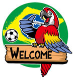 Macaw bird greeting with brazil flag as a background Stock Images