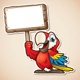 Macaw holding sign Royalty Free Stock Photo