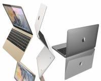 MacBook空气新的金子、银和空间灰色  免版税库存照片