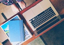 Macbook Air Beside 2 Books on Table Royalty Free Stock Images