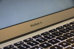 Macbook Air Grey Logo on Laptop Stock Photo