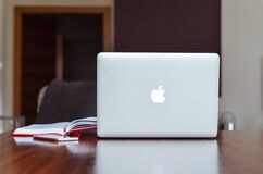 Macbook Air Near Red Book Stock Image