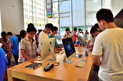 Macbook pro. Apple store in Nanjing Road, Shanghai. Many people are experimenting with Apples new products, ipad mini and iphone5 Royalty Free Stock Photography