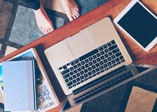 Macbook Pro Besides White Ipad on Table Royalty Free Stock Photo