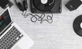 Macbook Pro Beside Black Headphones on Gray Table Stock Photo