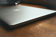 Macbook Pro on a desk Stock Images