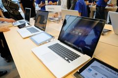 Macbook pro display in Apple store royalty free stock photography