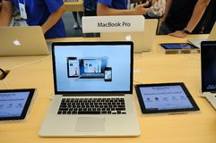 Macbook pro display in Apple store Stock Photography