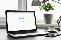 Macbook Pro with Google app on screen Royalty Free Stock Photography