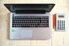 Macbook Pro Beside Gray Rectangular Device Royalty Free Stock Photo