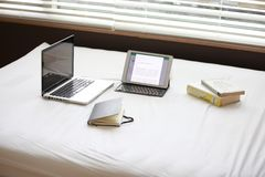 Macbook Pro over White Fabric Sheet Beside White Ipad Royalty Free Stock Image