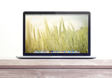 Macbook pro retina on the desk. Macbook pro  with retina display on the desk Stock Photo
