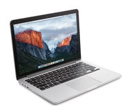 Macbook Pro with with Retina display. Kiev, Ukraine - May 15, 2016:Brand new Macbook Pro with with Retina display and OS X EL Capitan isolated. MacBook is a Royalty Free Stock Photos
