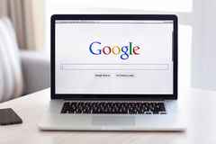 MacBook Pro Retina with Google home page on the screen stands on Royalty Free Stock Photos