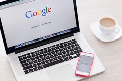 MacBook Pro Retina and iPhone 5s with Google home page on the sc Stock Images