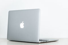Macbook pro retina 13. On the table with white background Royalty Free Stock Image